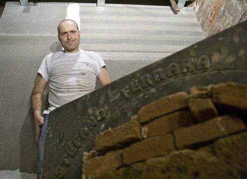 Stefano Ferrara building an oven